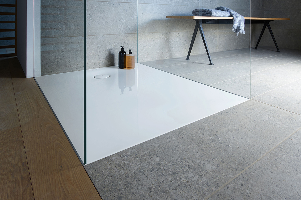 Flush-fitted shower tray with grey tiles and wood-effect flooring