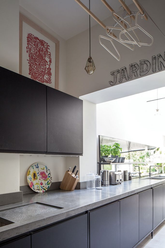 Industrial black cabinetry with concrete worktop