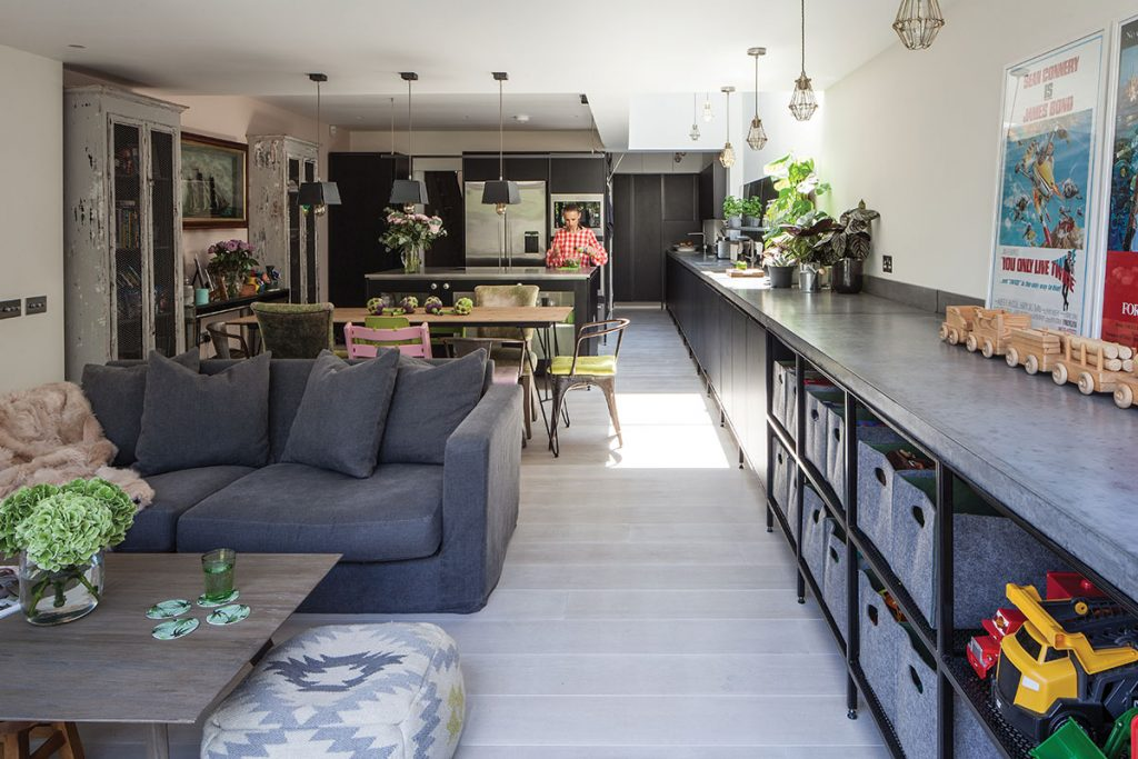 Industrial kitchen with a sitting area and long run of cabinetry