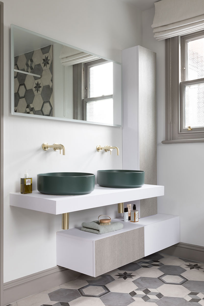 Double vanity with green basins and large mirror