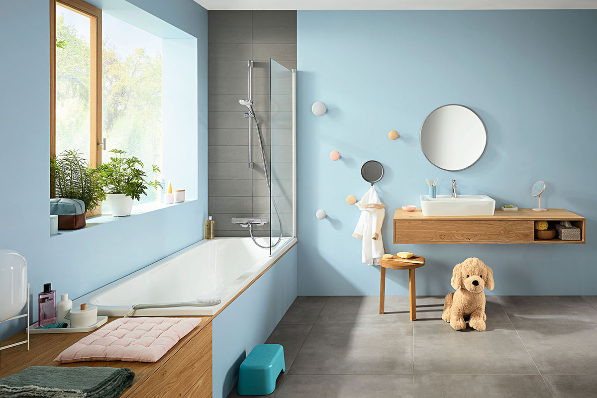 Blue family bathroom with large bath and vanity
