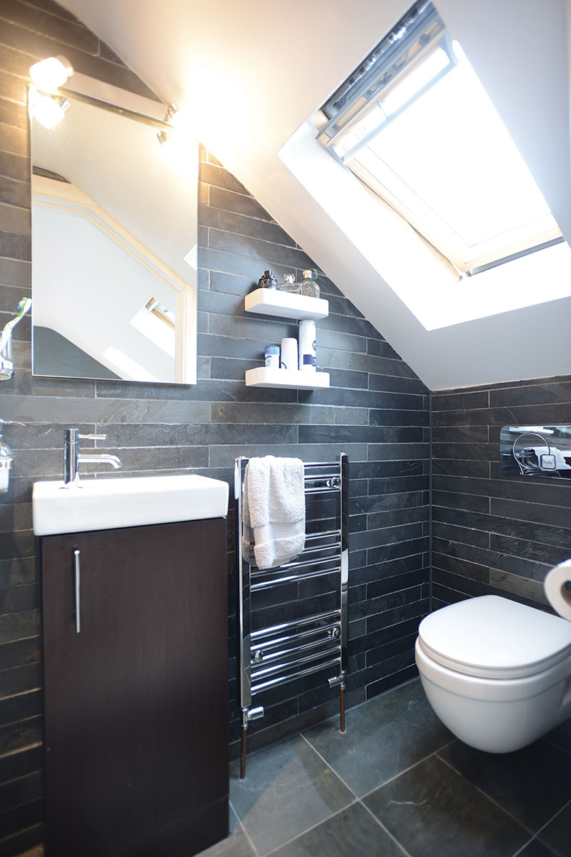 Bathroom with sloped roof
