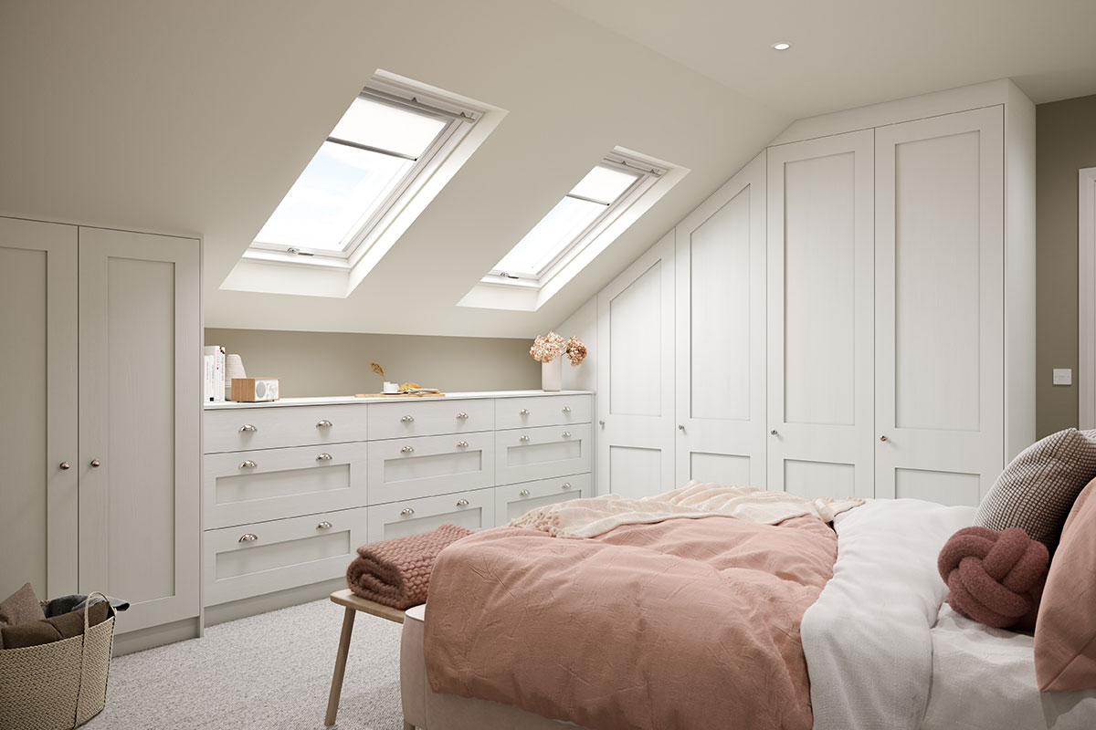 Bedroom under eaves with fitted storage under the eaves and on a tall wall