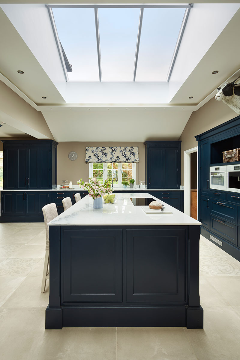 Large kitchen island under skylight