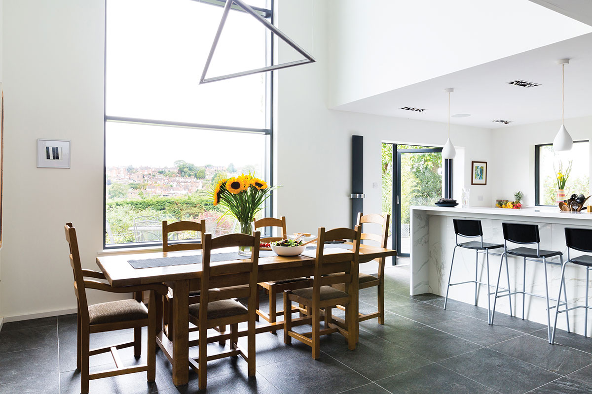 Open-plan kitchen and dining area linked to the garden