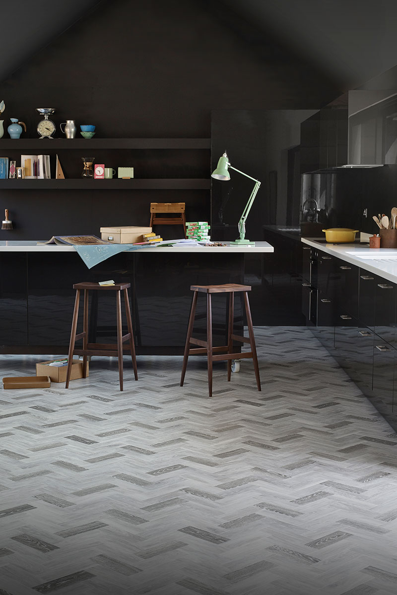 Wood-effect vinyl in a black kitchen