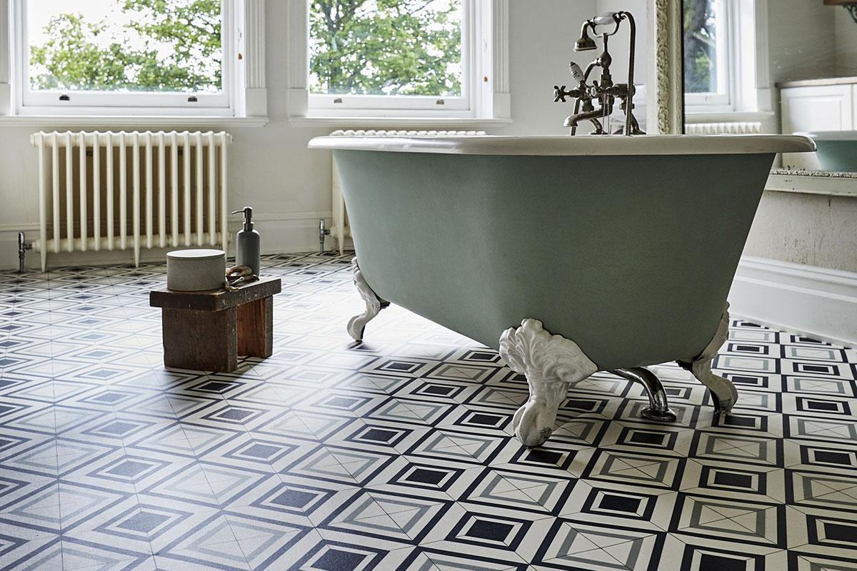 Blue-green freestanding bath on geometric vinyl