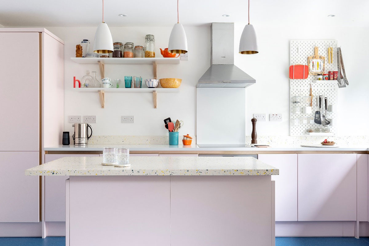 Pastel kitchen in soft pink with white island