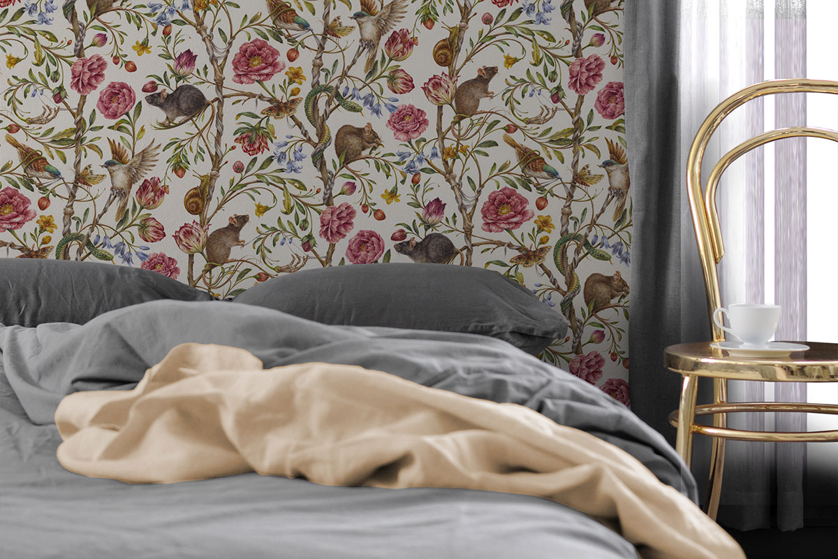 Bedroom with neutral bedding and floral patterned wallpaper