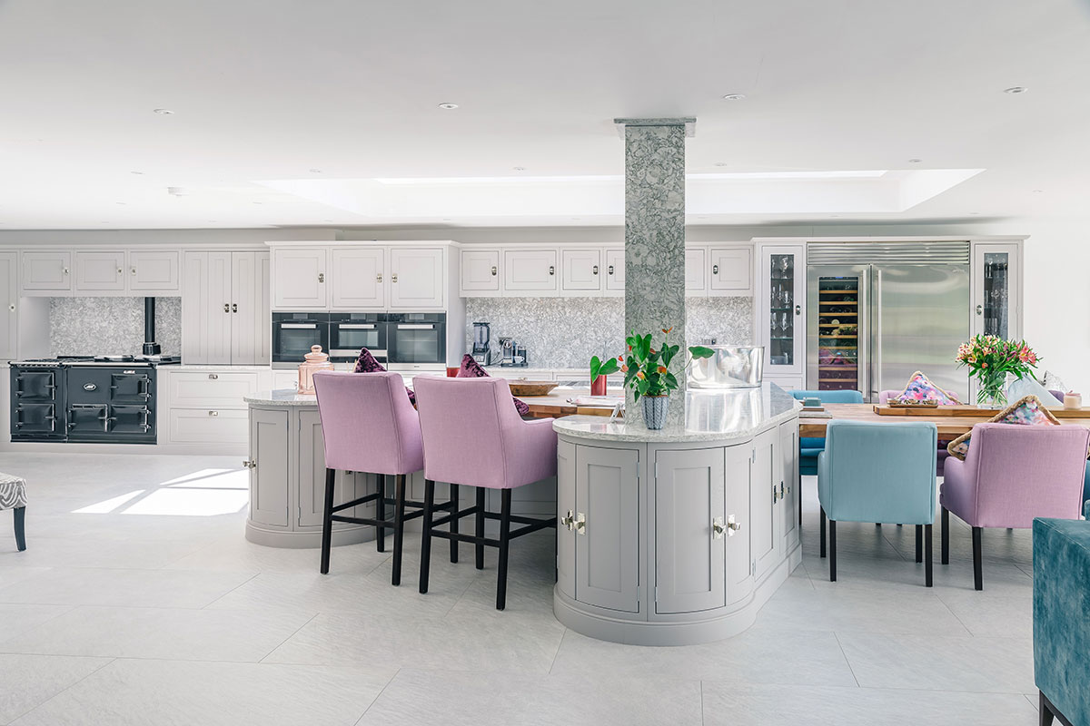More traditional grey kitchen with pillar and colourful seats