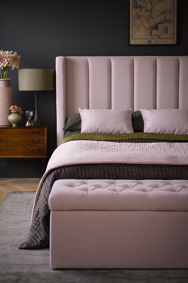 Bed with high headboard in soft pink