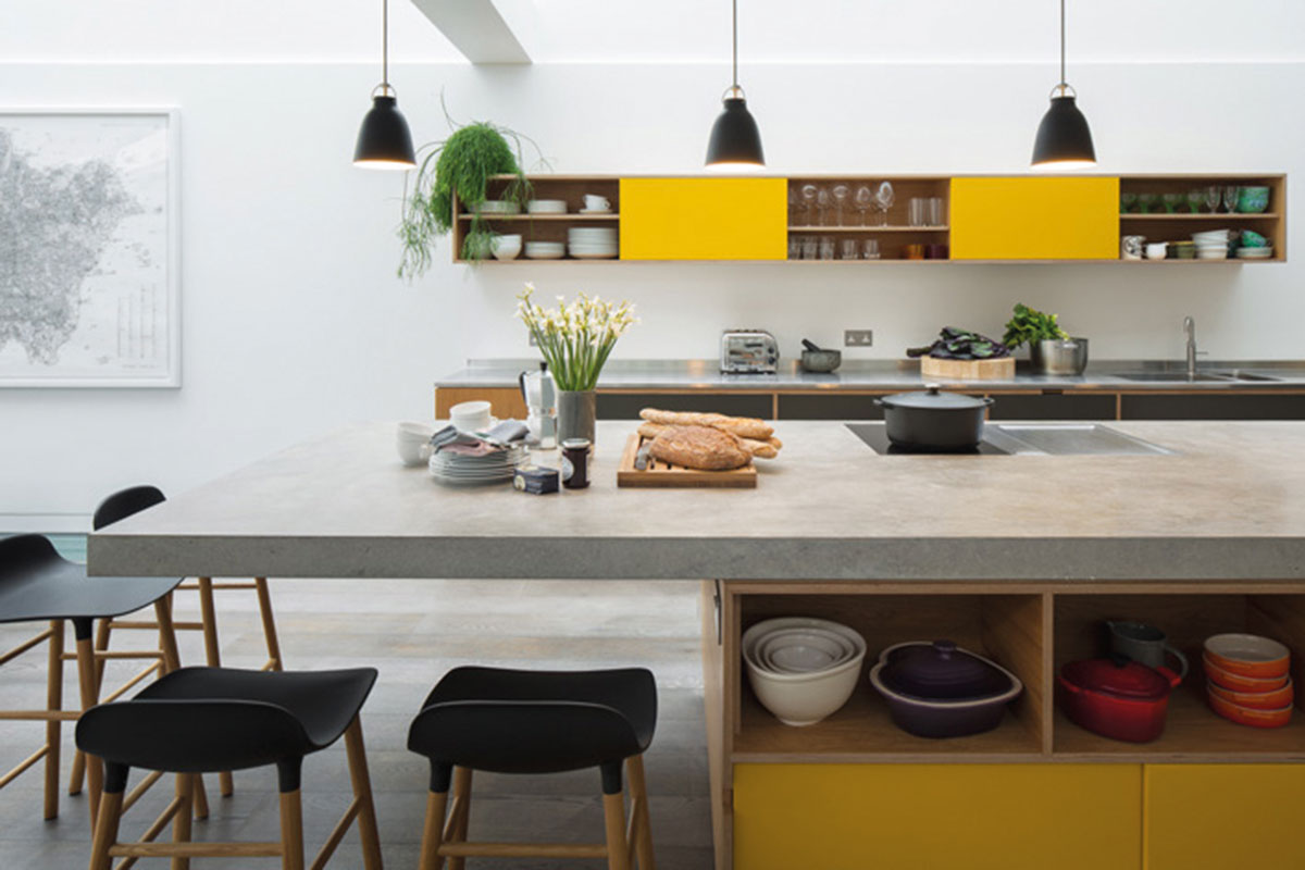 A kitchen with a concrete worktop