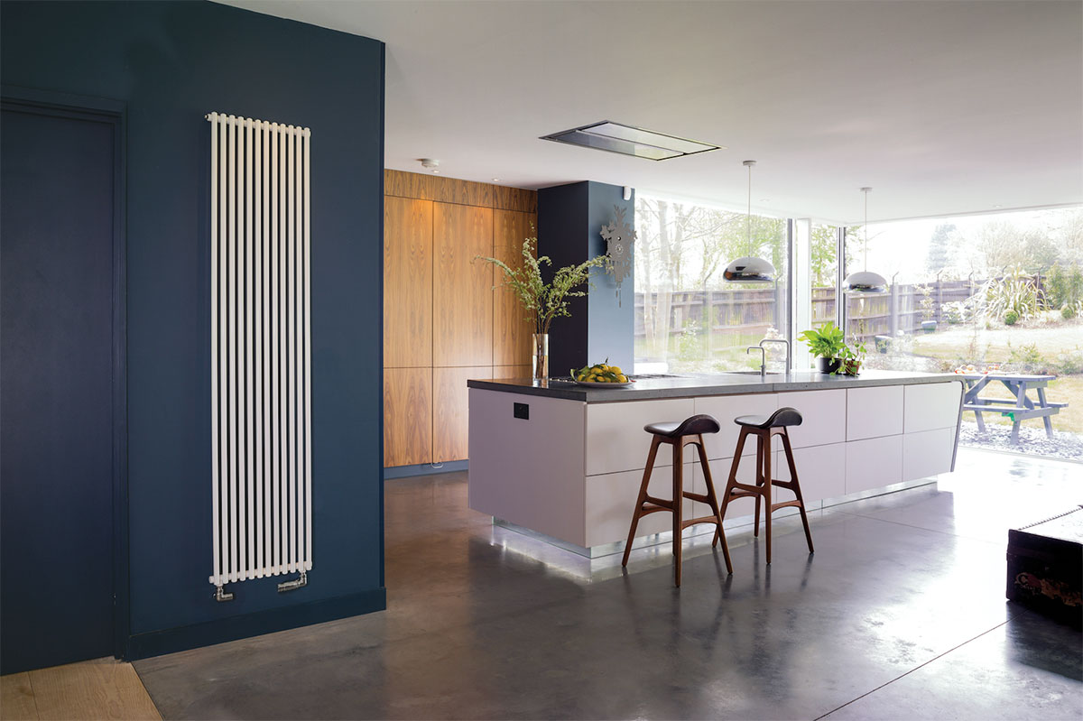 This kitchen features a long radiator