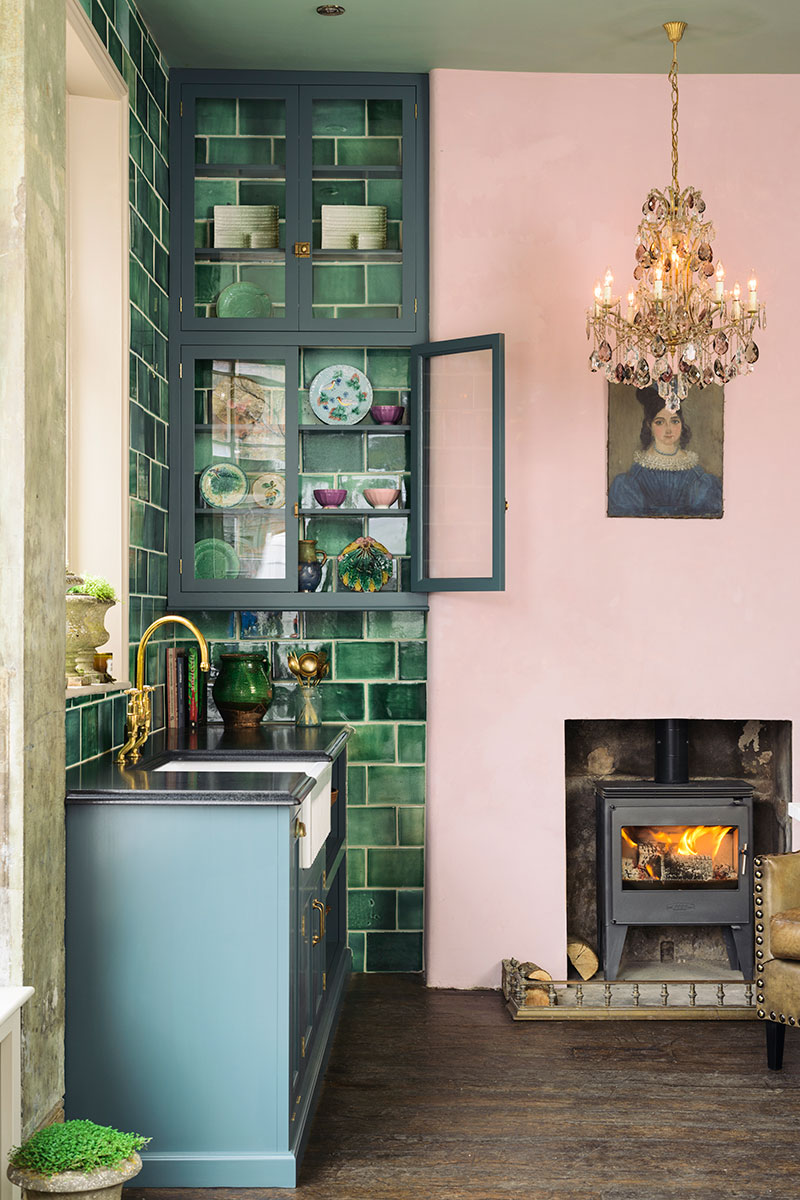 Devol kitchen with green tiles and pink wall