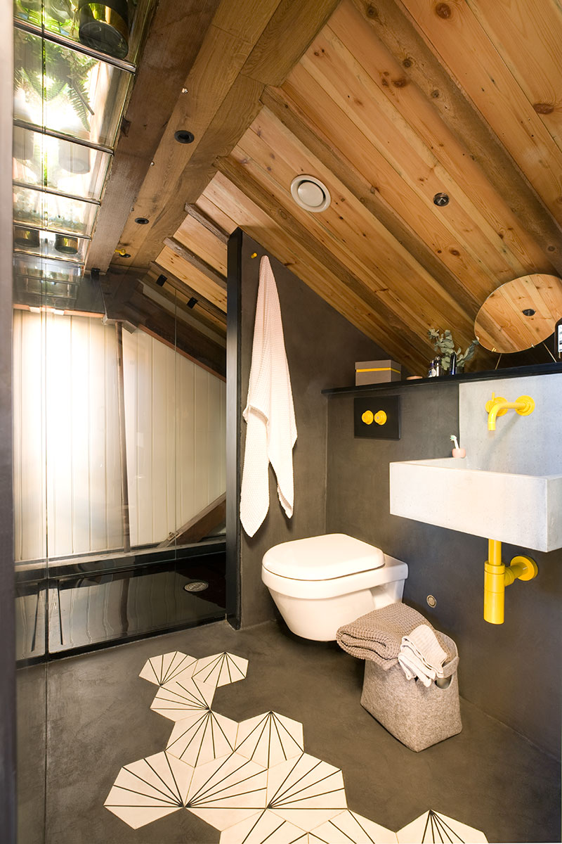 black and yellow bathroom with roof glazing