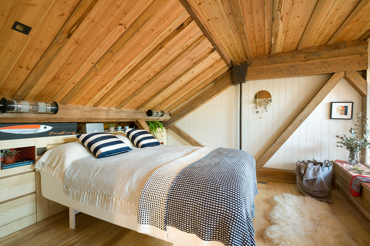 scandi inspired bedroom with wood panel ceiling