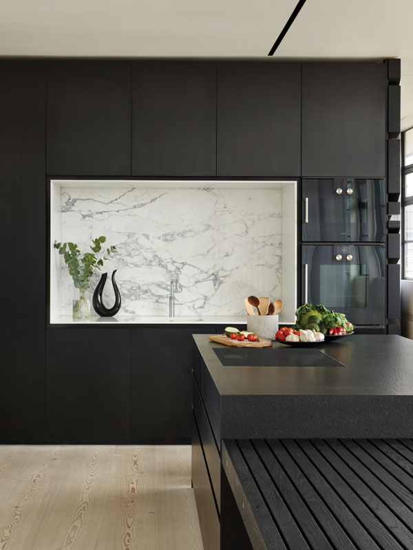 Black kitchen appliances and cabinets