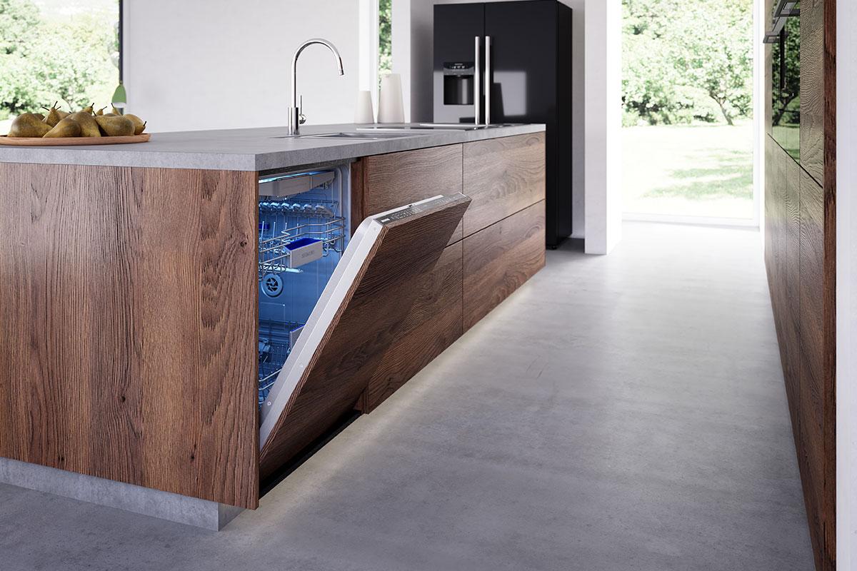 Siemens iQ integrated dishwasher behind wooden front