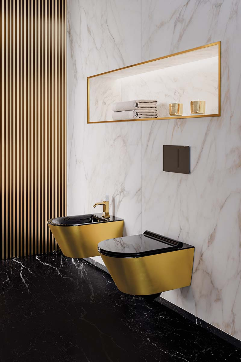 Gold and black toilet and bidet
