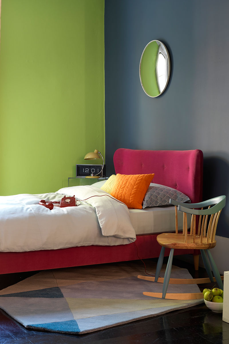 Renovate a small bedroom pink headboard in front of green wall