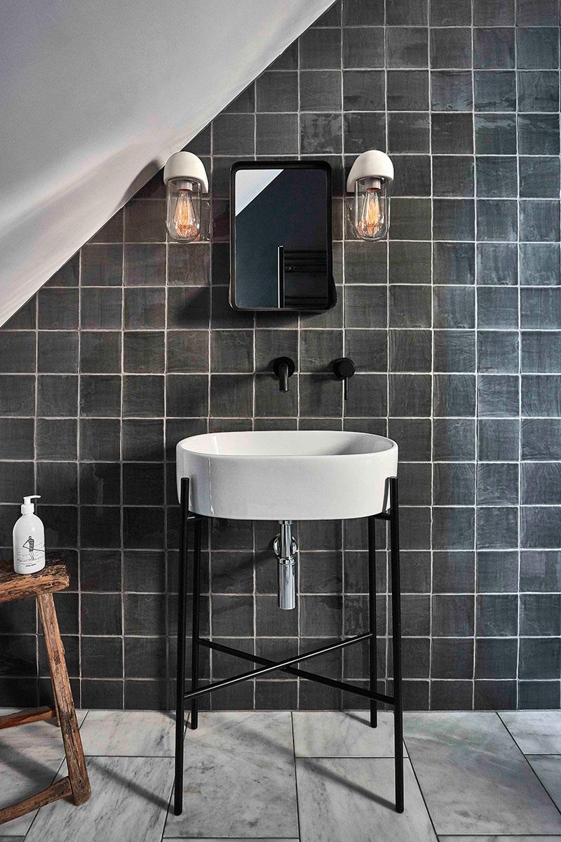 Garden trading industrial bathroom scheme with wall lighting