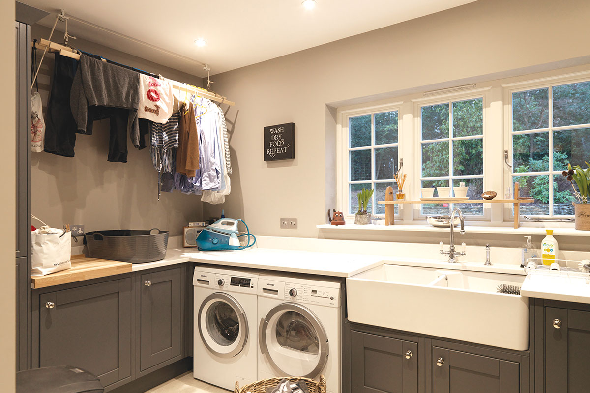 Utility room with large sink and laundry room
